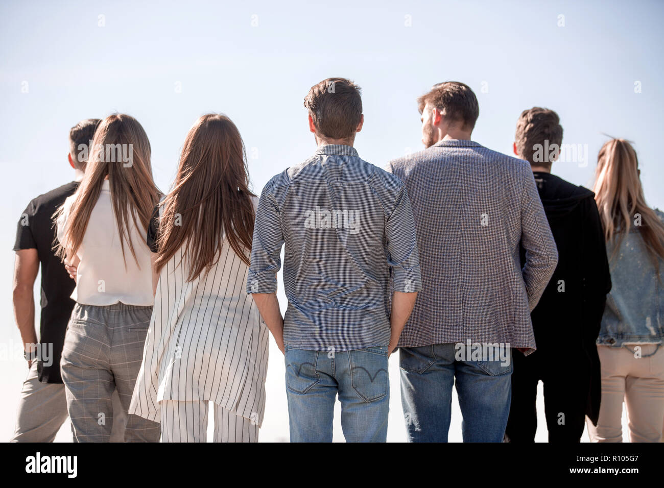 rear view . group of friends looking at copy space - Stock Image
