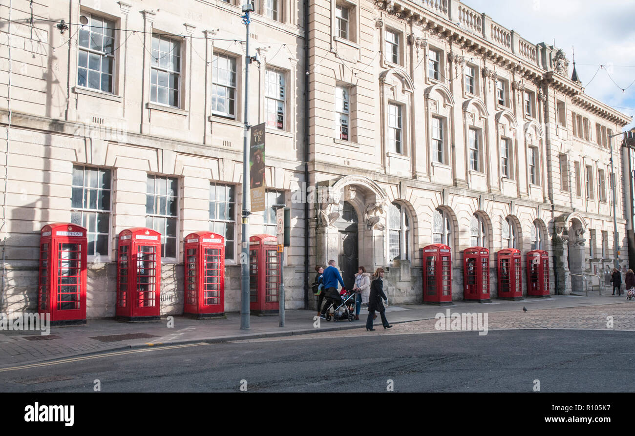 Row of eight old style K2 phone boxes outside old General Post Office and Sorting office building in Abingdon street Blackpool Lancashire England UK - Stock Image