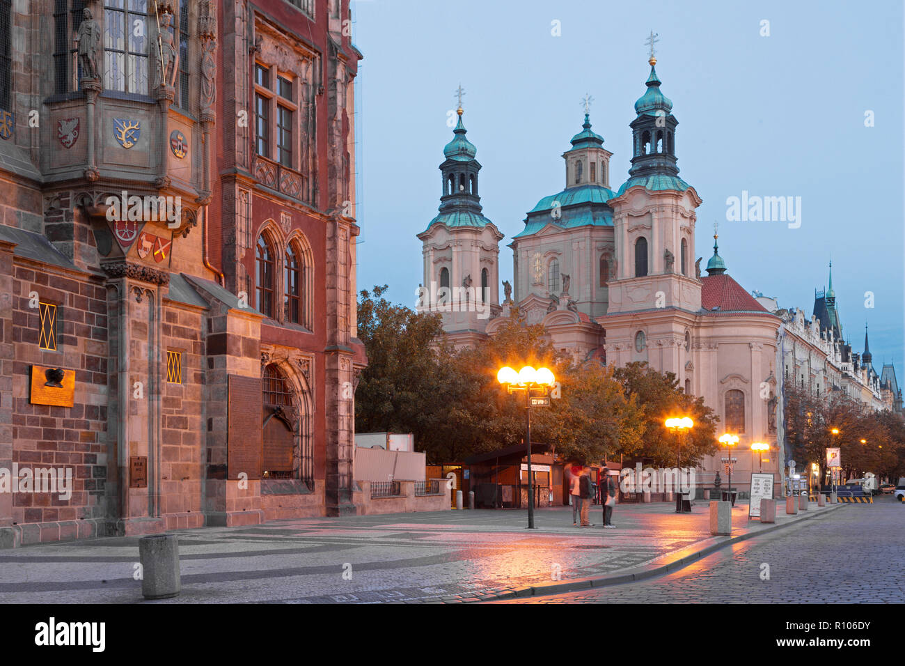 Prague - The Old Town hall, Orloj, Staromestske square and St. Nicholas church at dusk. - Stock Image
