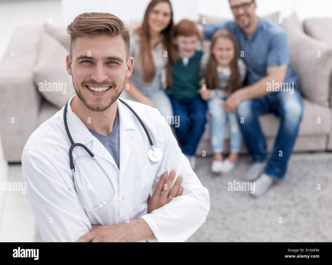 family doctor and his happy patients - Stock Image