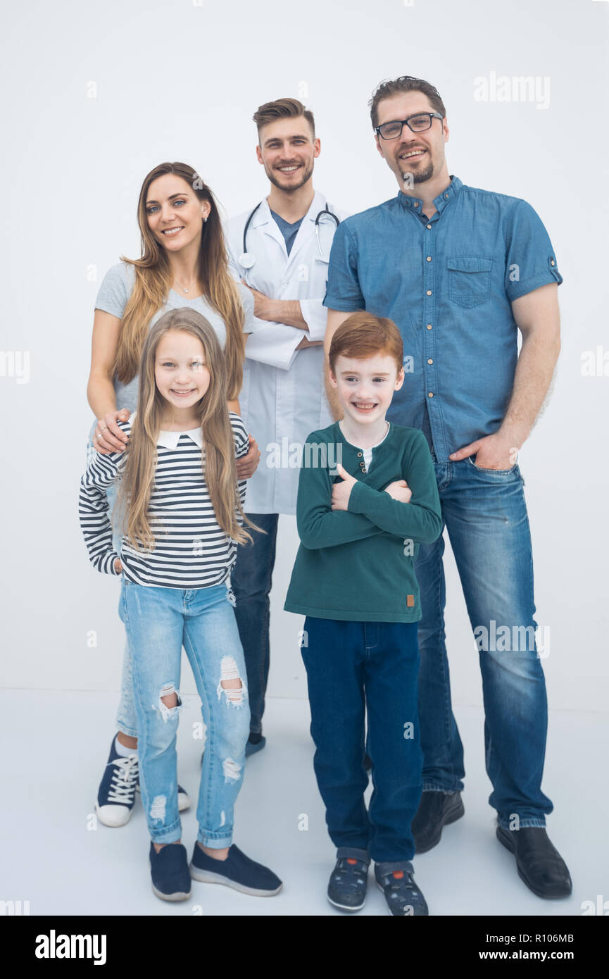 portrait of a modern family with their family doctor. - Stock Image