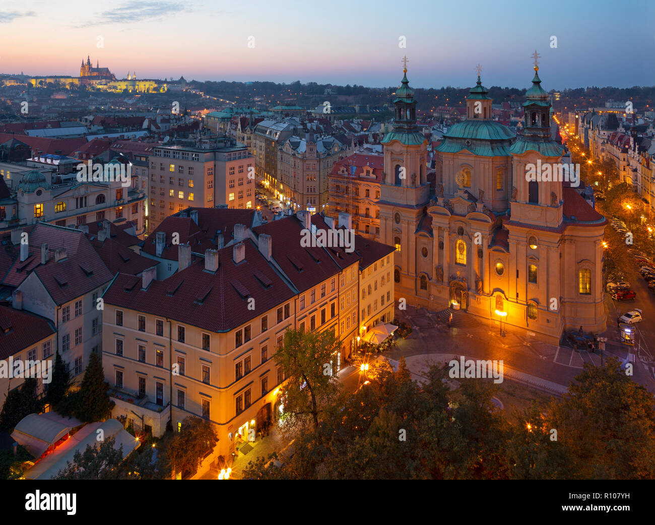 Prague - The St. Nicholas church,   Staromestske square and Old Town at dusk. Stock Photo