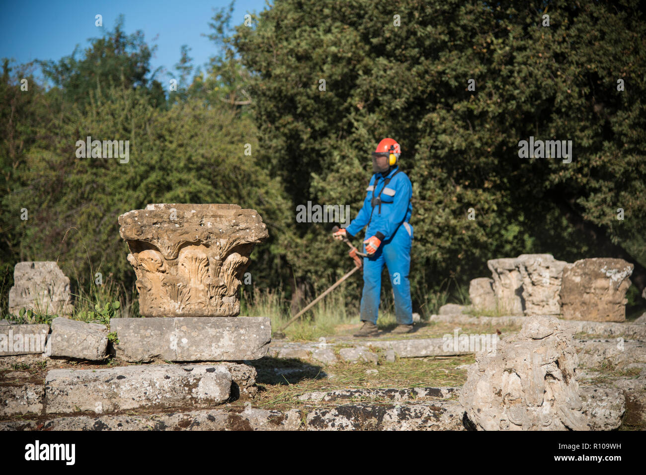 Grounds maintenance worker at Olympia. - Stock Image