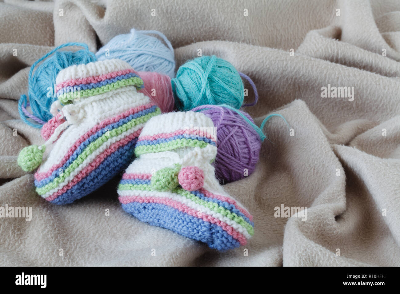 Baby birthday announcement with booty on soft cloth - Stock Image