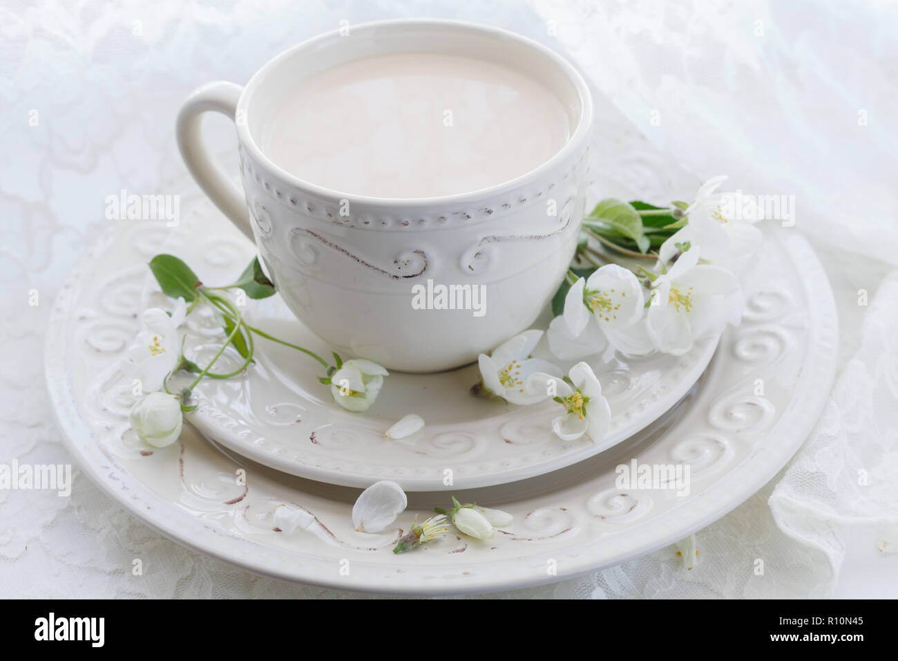 Masala tea chai latte homemade traditional Indian sweet milk with spices beverage in porcelain cup on wooden table background Stock Photo
