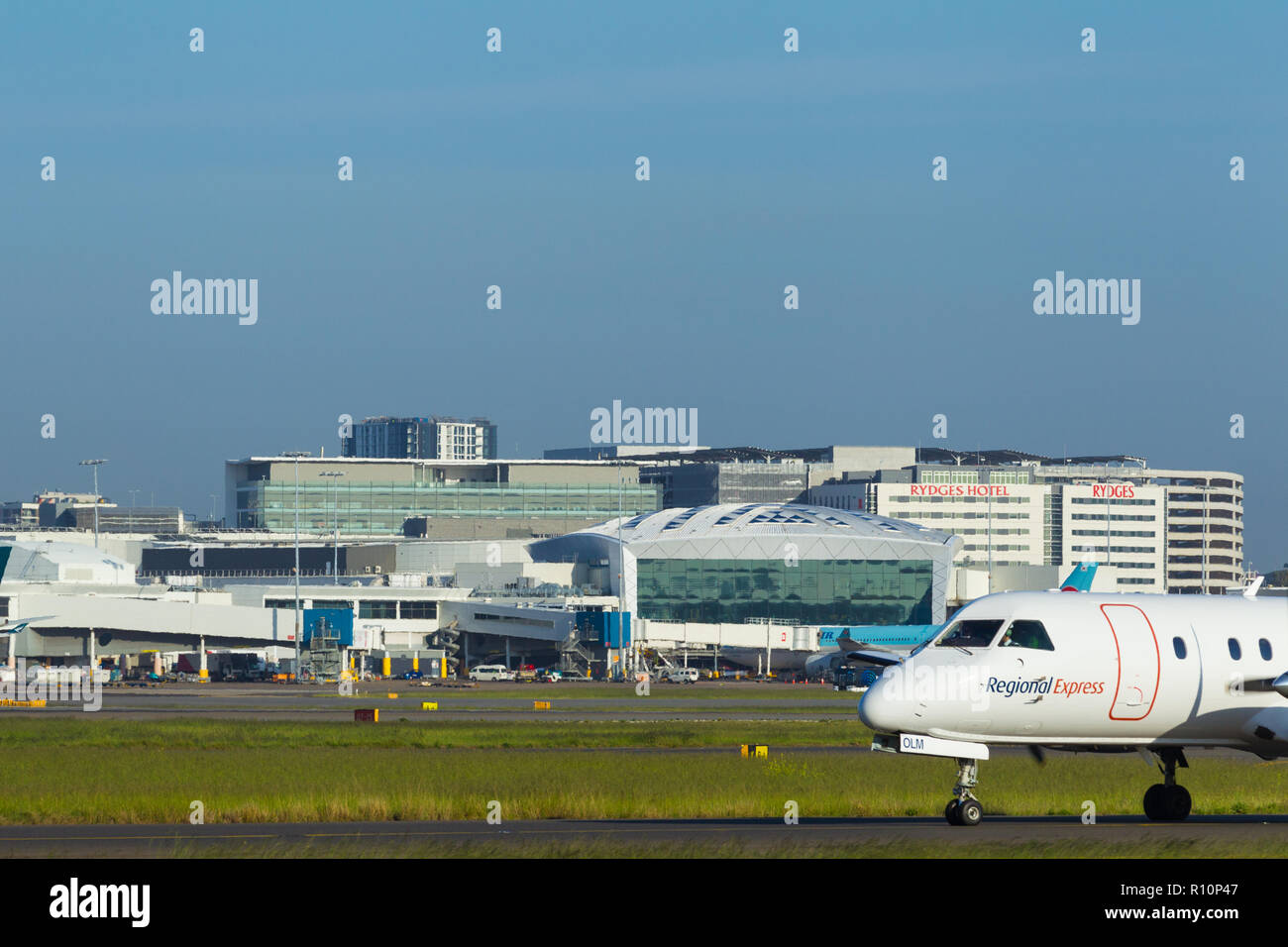 Detail from Sydney (Kingsford Smith) Airport in Sydney, Australia, looking towards the International Terminal on the western side of the airport. Pictured: a REX Regional Express aircraft taxying. - Stock Image
