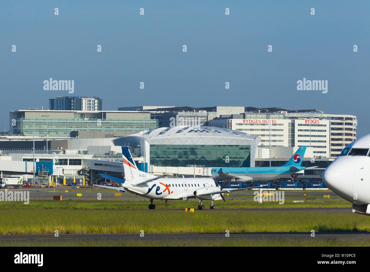 Detail from Sydney (Kingsford Smith) Airport in Sydney, Australia, looking towards the International Terminal on the western side of the airport. Pictured: VH-ZLC REX (Regional Express) Saab 340B. - Stock Image