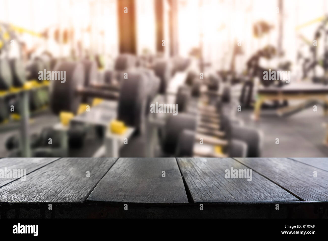 Empty table montage with blur fitness gym room on background stock