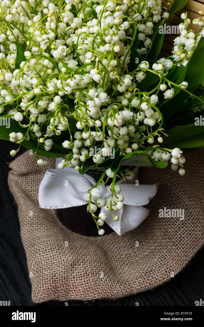 Lily Of The Valley Flowers In Glass Vase Black Background