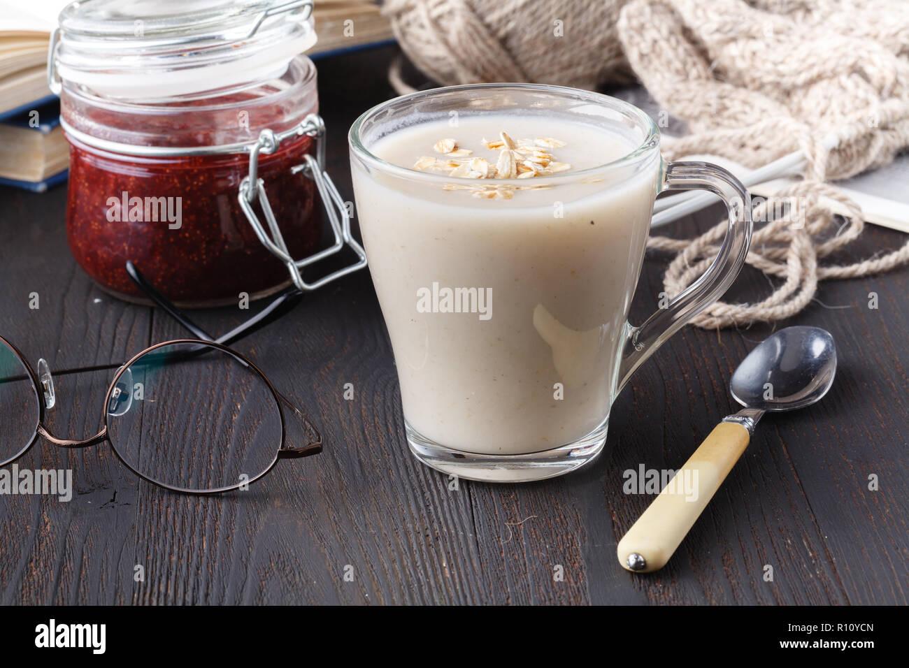 Non-dairy vegan oat milk with berries, healthy diet - Stock Image