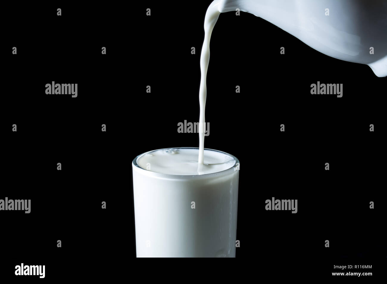 pouring-stream-of-milk-from-a-jug-in-a-o