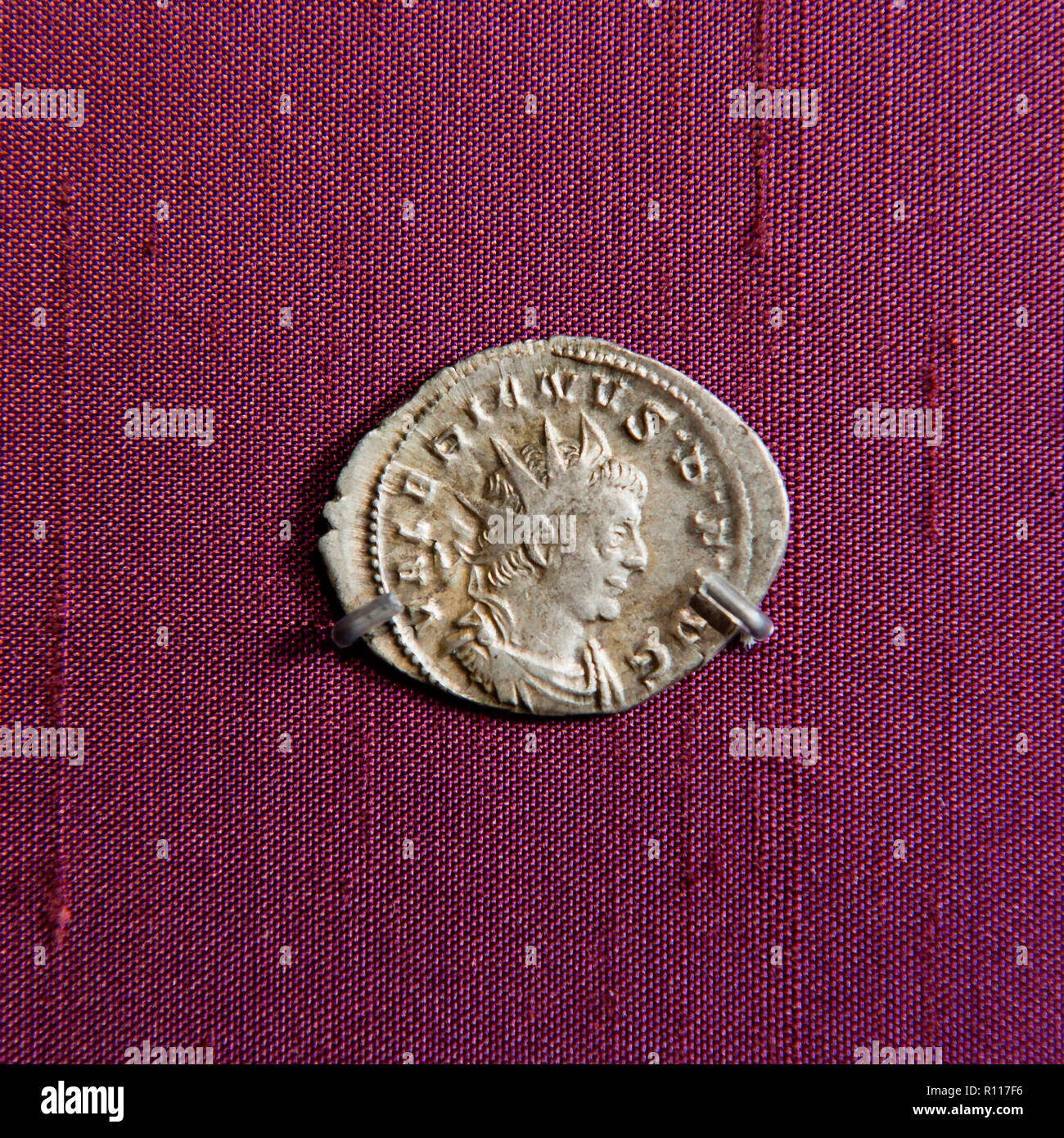 Man's profile on ancient coin Stock Photo