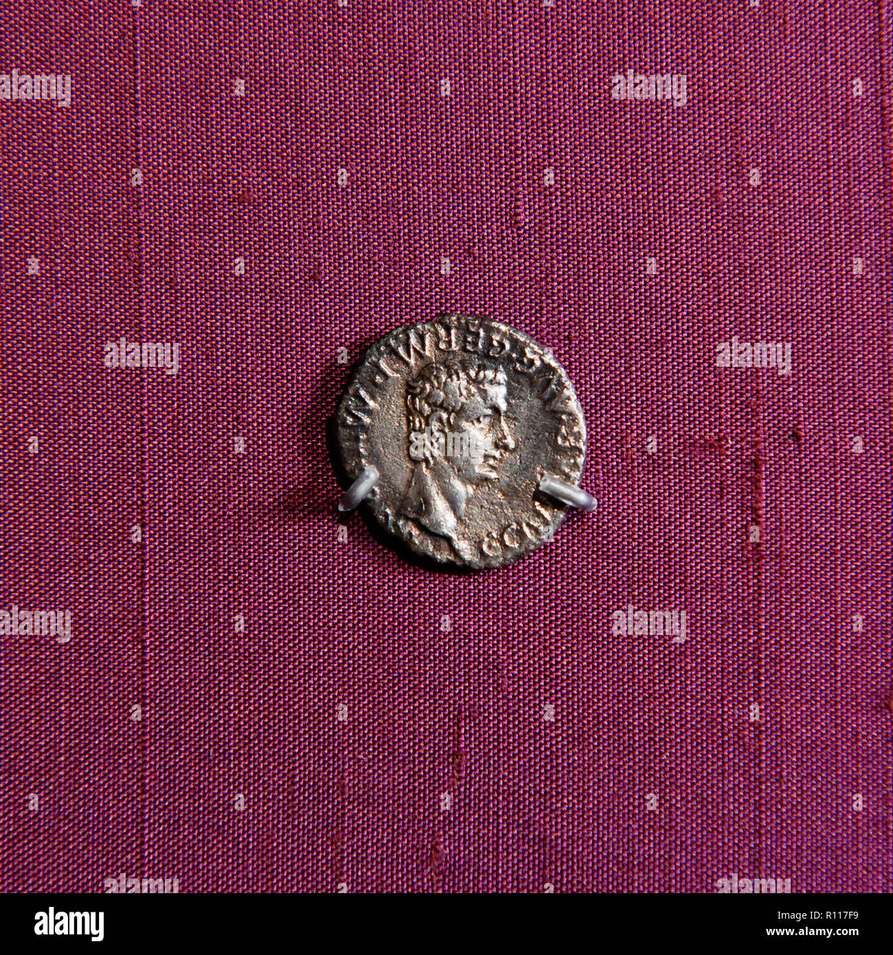 Man's profile on ancient coin - Stock Image