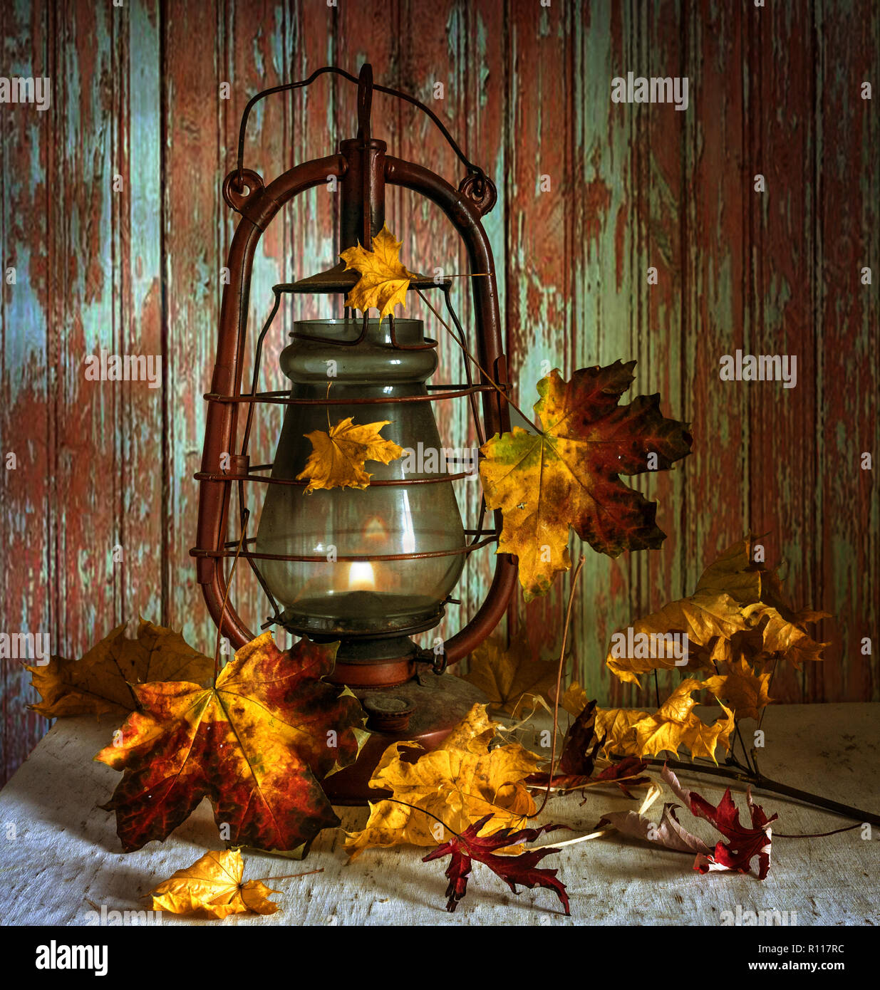 still life with autumn leaves and a kerosene lamp. vintage Stock Photo