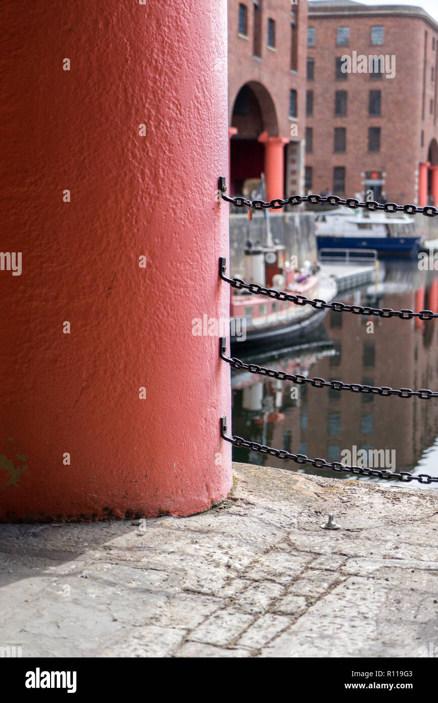 The cast iron columns that support the historic buildings the surround the Royal Albert Dock in Liverpool. - Stock Image