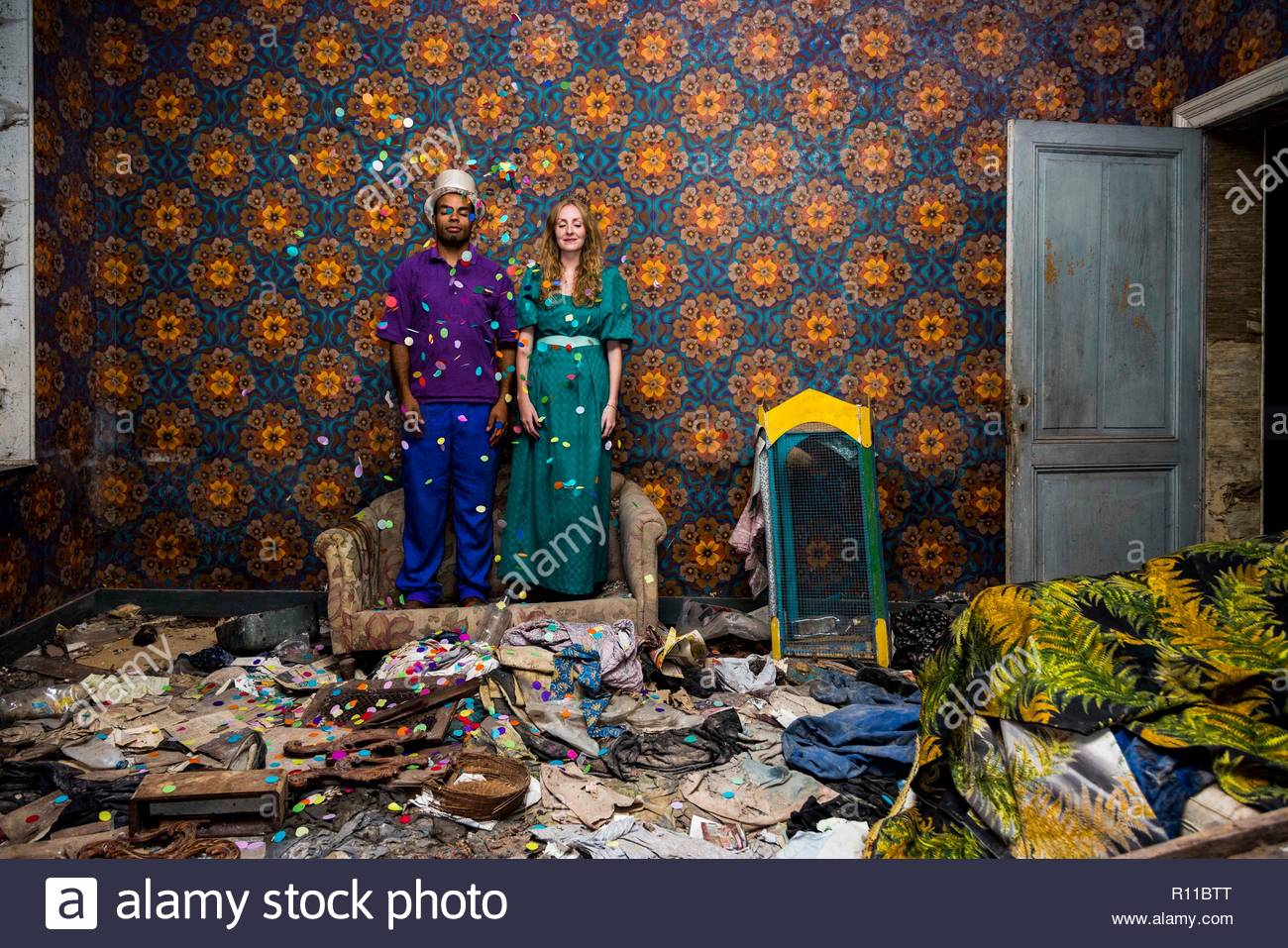 Two people in a messy house - Stock Image