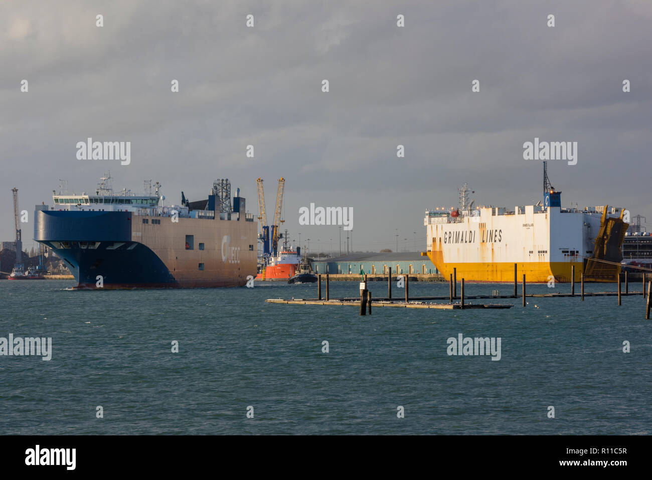 car transporter shipping and ships for carrying cars and vehicles in the busy harbour at the port of southampton docks. car carriers. - Stock Image