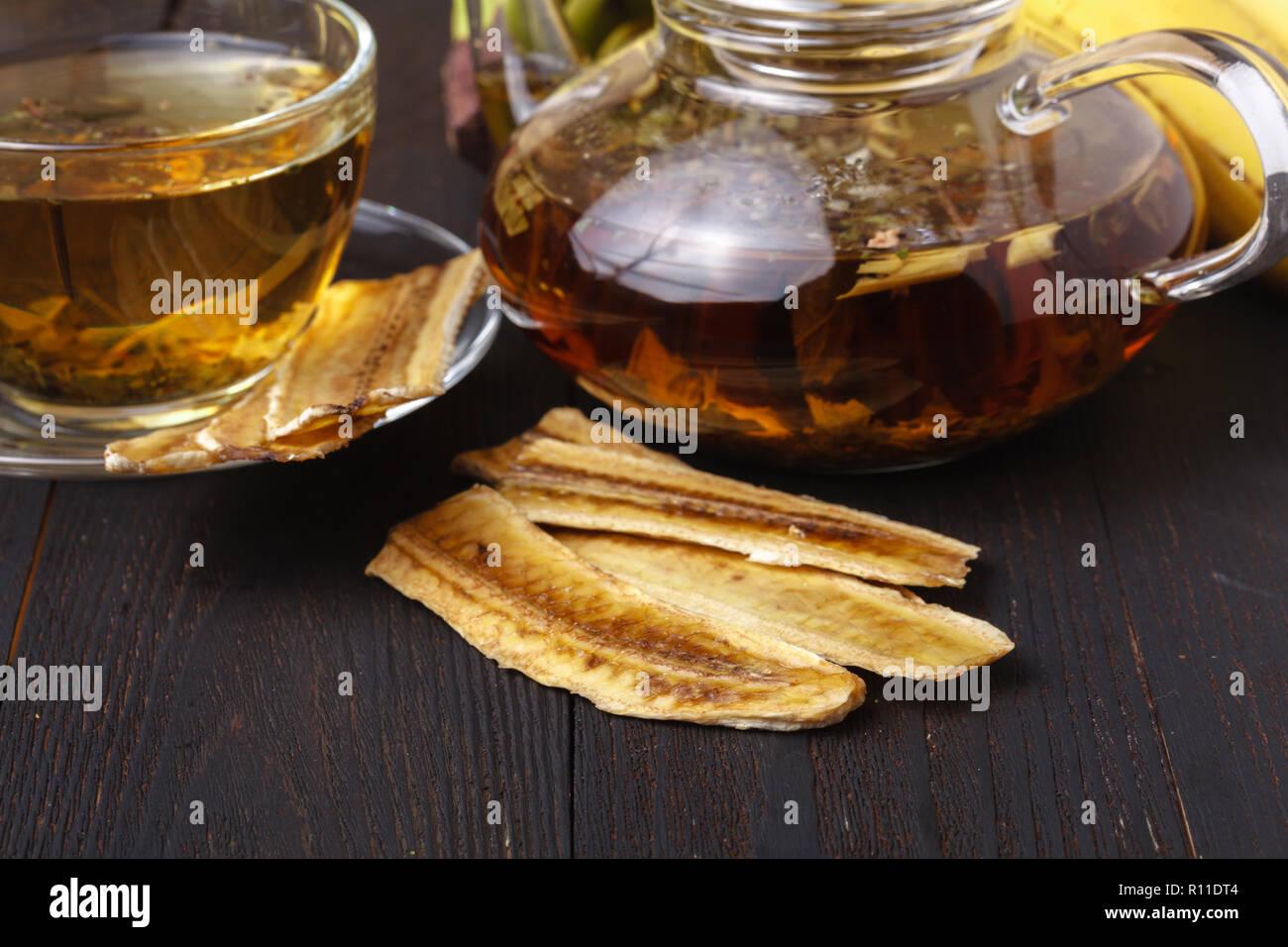 Sun-dried banana,dried banana with tea on wood background Stock Photo