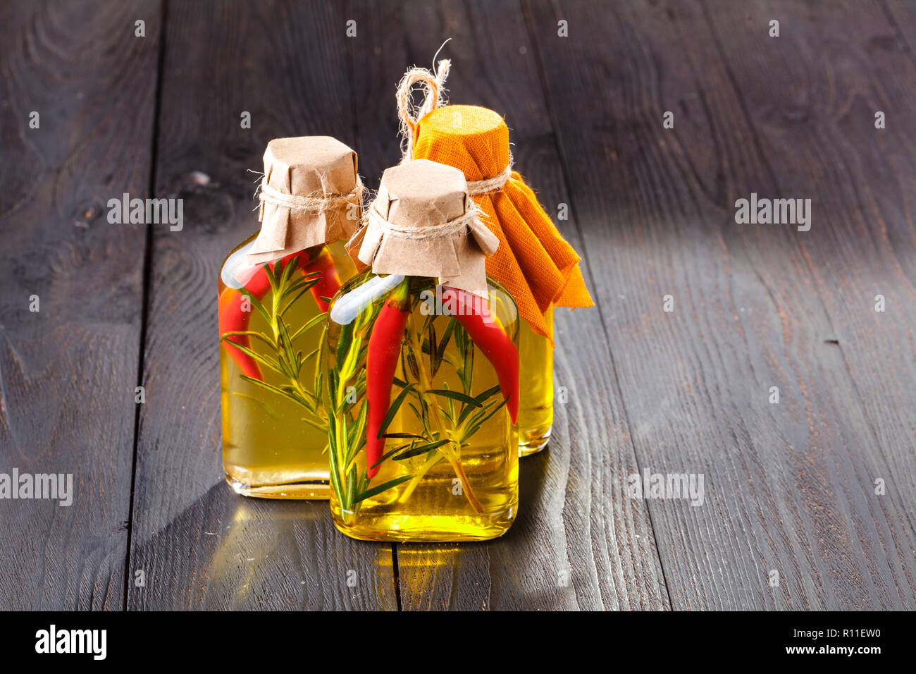 Oil Bottles with Aromatic Herbs Stock Photo