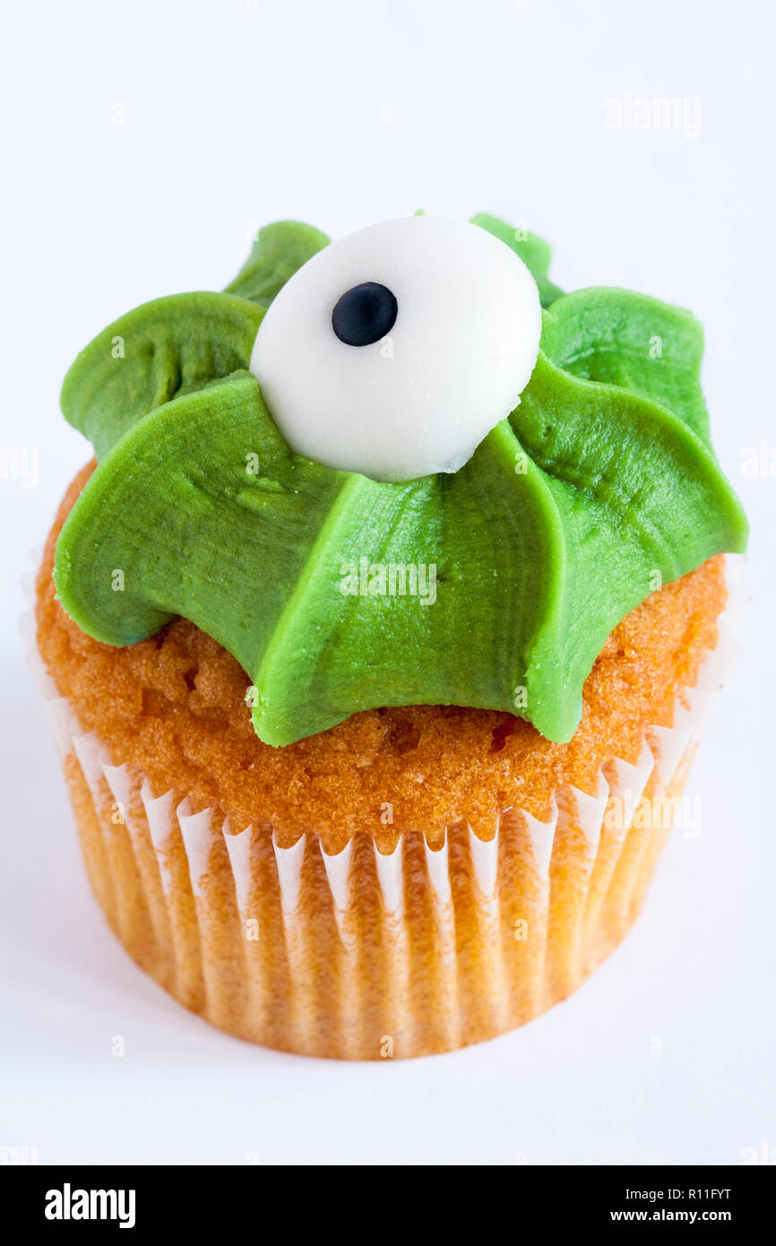 M&S mini monster cupcake toffee & apple cake finished with fondant icing eyeball for Halloween from mini monster cupcake selection on white background - Stock Image