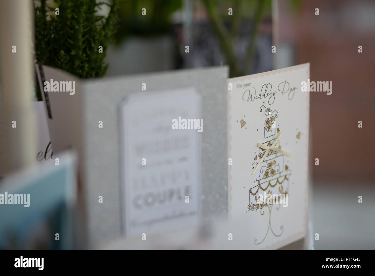 A wedding card standing on a shelf - Stock Image
