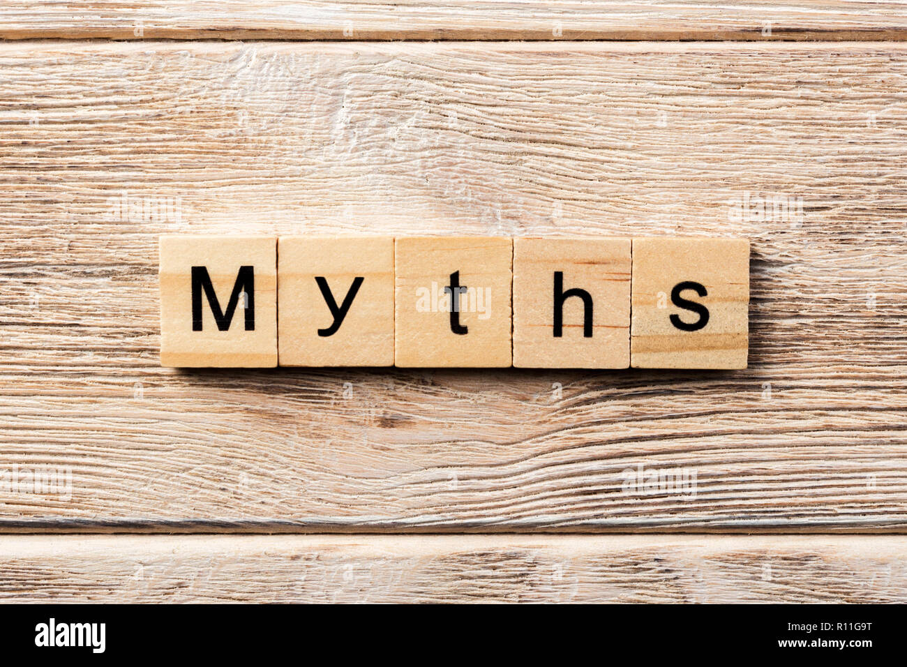 myths word written on wood block. myths text on table, concept. - Stock Image