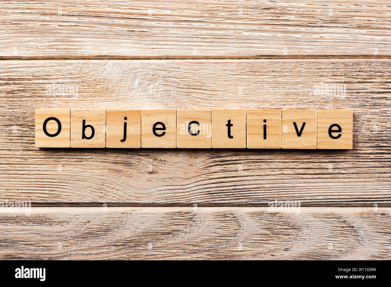 objective word written on wood block. objective text on table, concept. - Stock Image