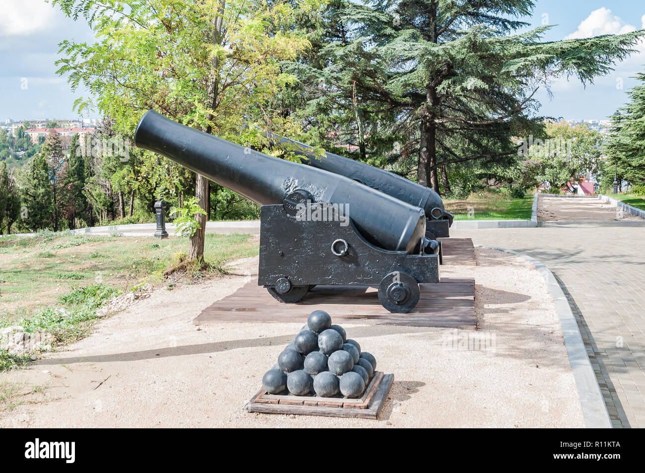 Old cannons on wooden carriages and defensive fort cores. Military Museum. - Stock Image
