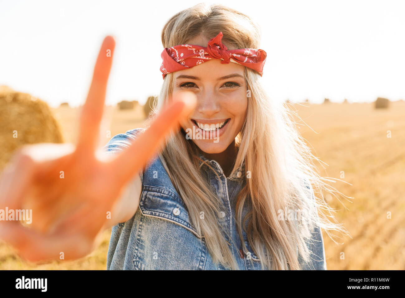 Beautiful Young Blonde Girl In Headband At The Wheat Field Showing