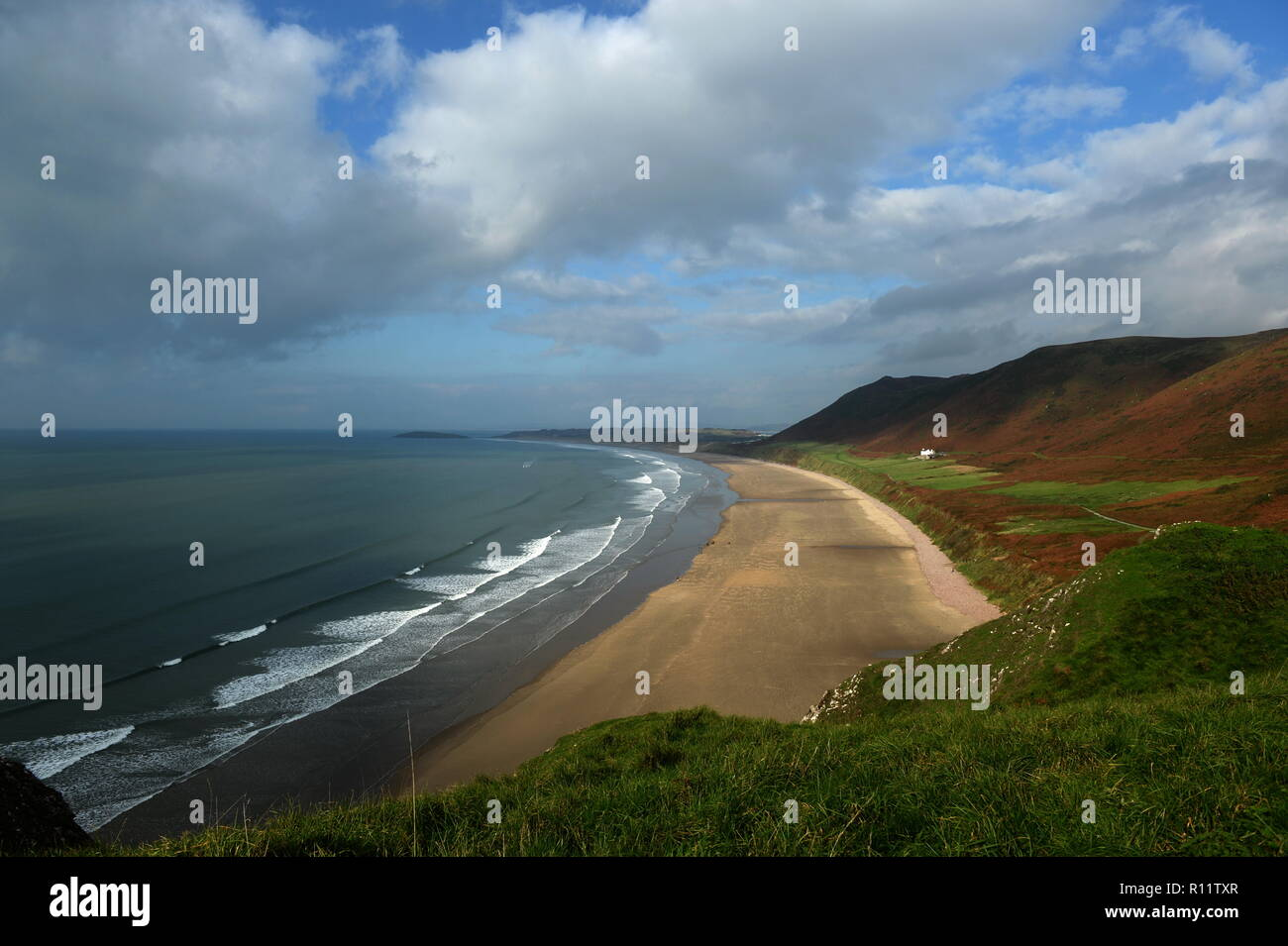 The iconic view from Rhossili over the bay, Llangennith beach and Rhossili down - Stock Image