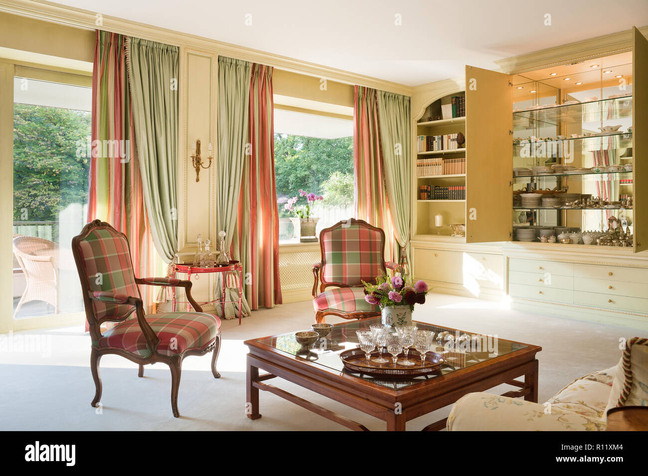 Edwardian living room with checked armchairs - Stock Image