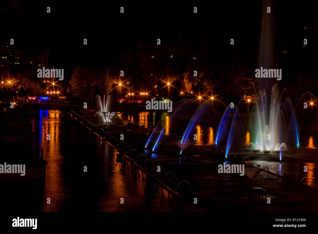 Glowing multicolored illumination fountains in the Far Eastern city of Khabarovsk. - Stock Image