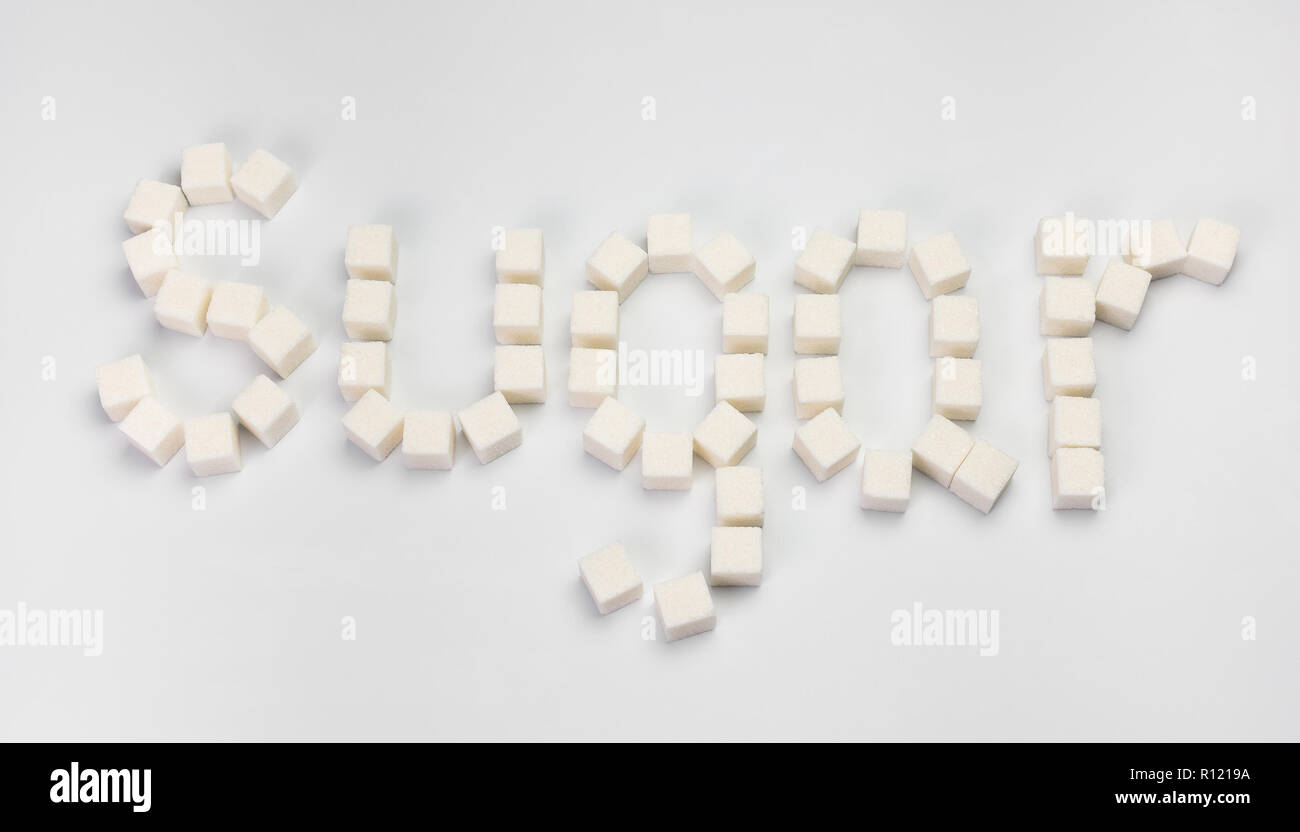 word sugar made up of sugar cubes on a white background - Stock Image