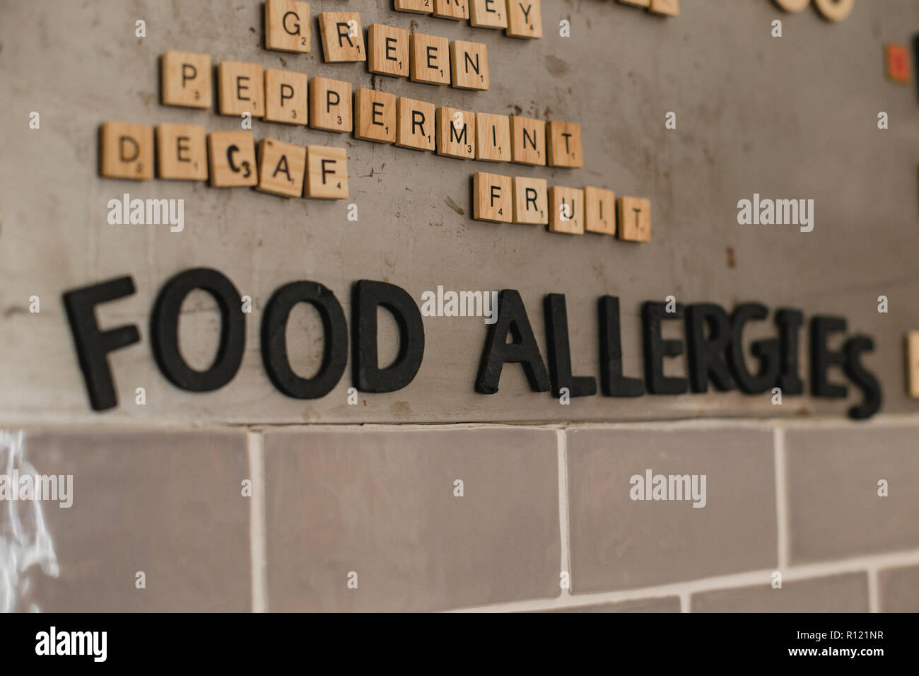 Low Angle View Of Food Allergies Menu On The Wall In A Cafe They Have Used Little Tile Letters To Show The Words Stock Photo Alamy