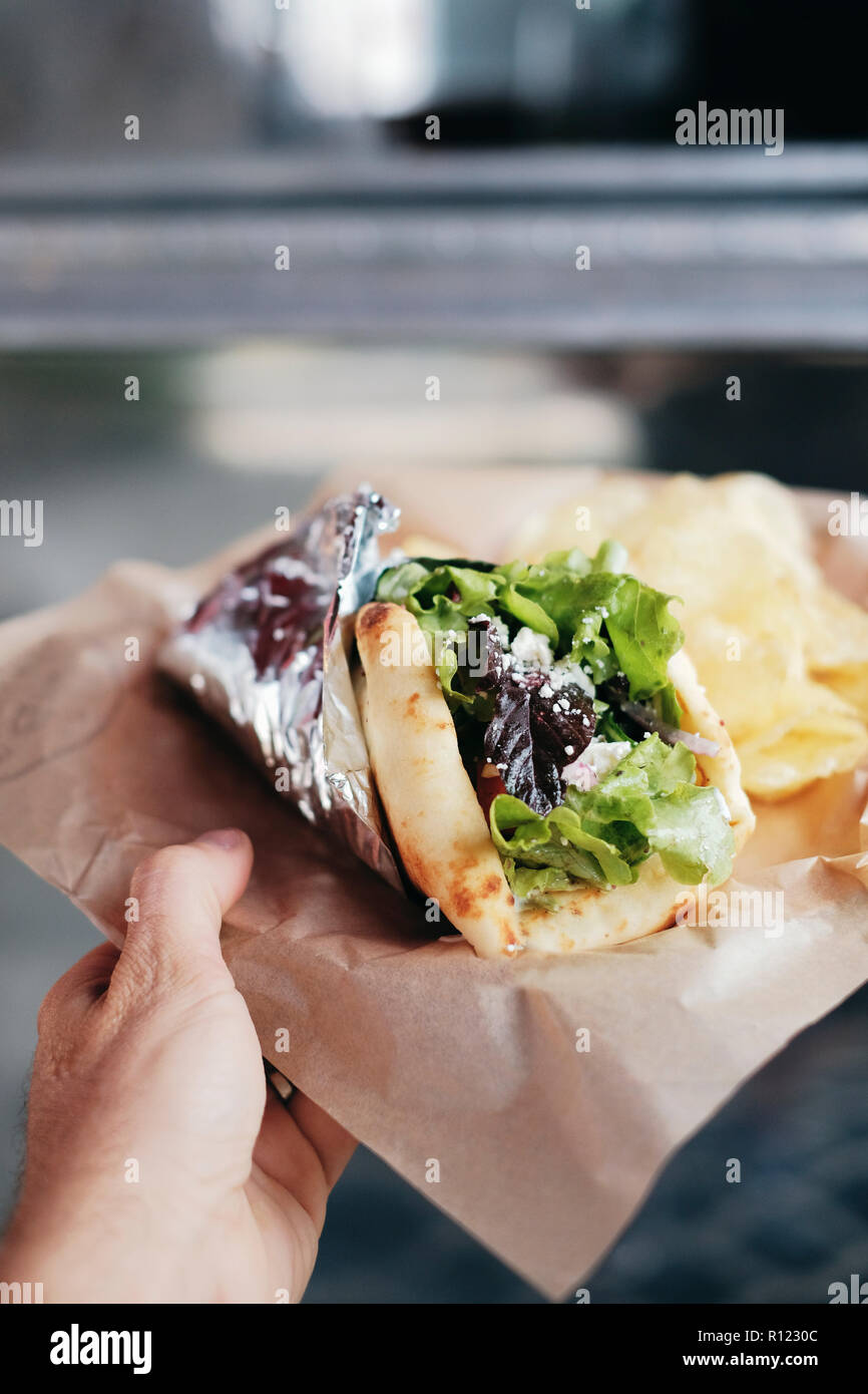 Meal of salad wrap and potato chips - Stock Image