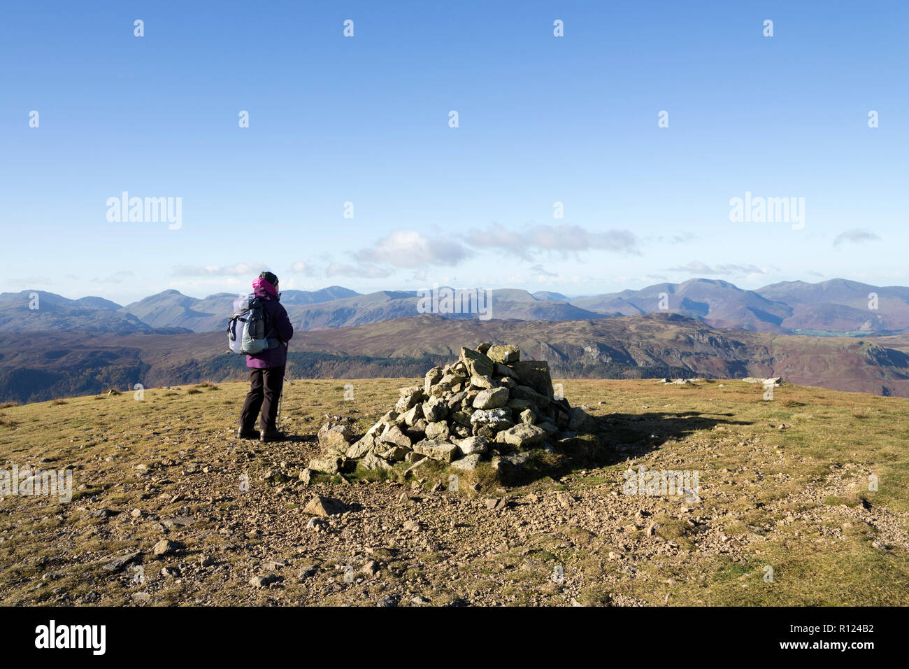 Walker on the Summit of Watson's Dodd with the View West towards the Derwent Fells, Lake District, Cumbria, UK - Stock Image