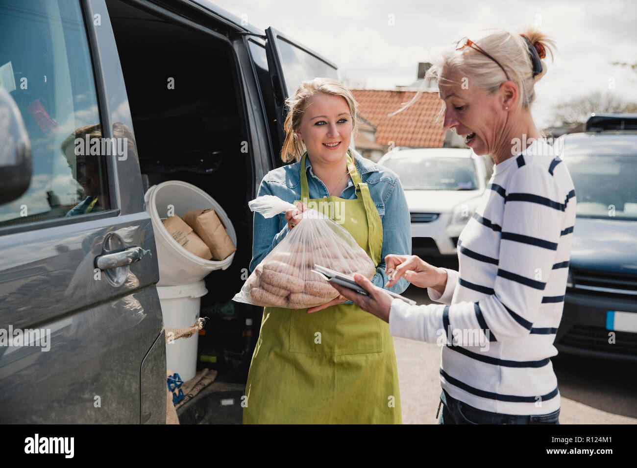 Ordering From A Food Van Stock Photos & Ordering From A Food