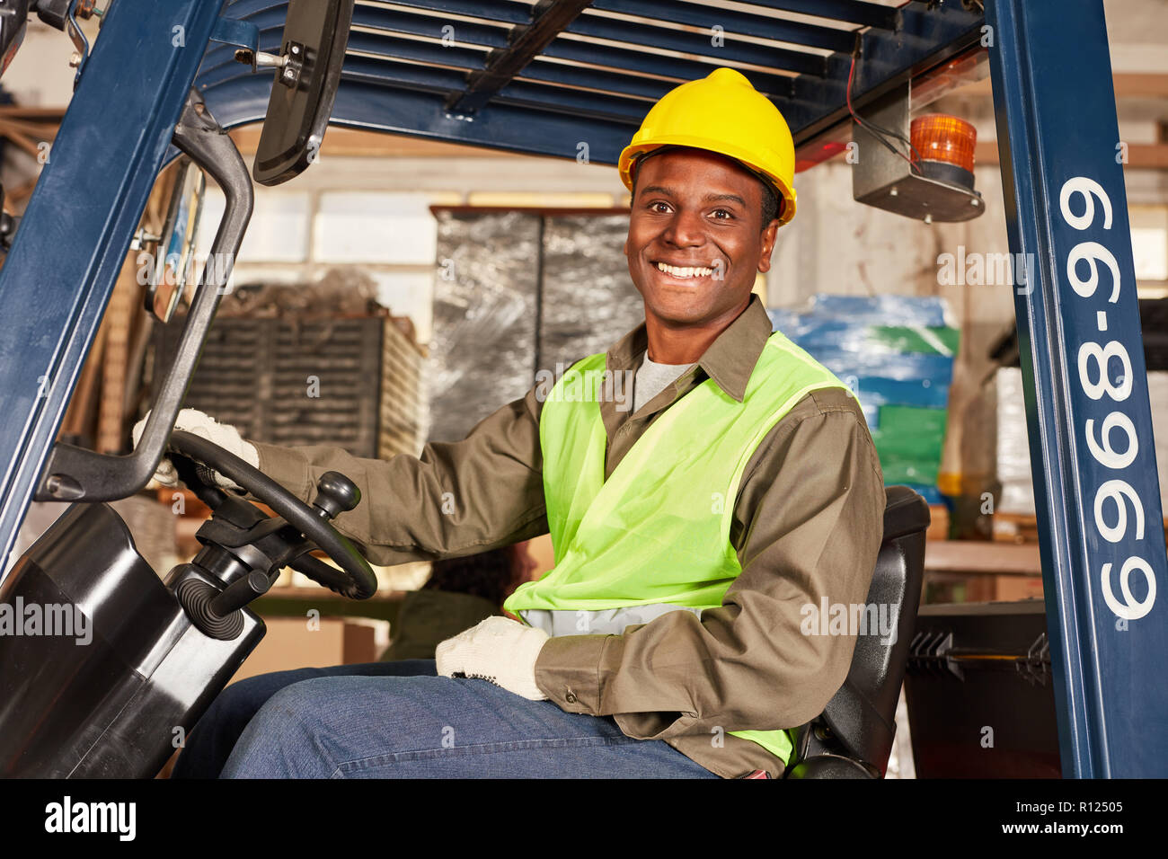 African man as a forklift driver in training in the logistics center Stock Photo