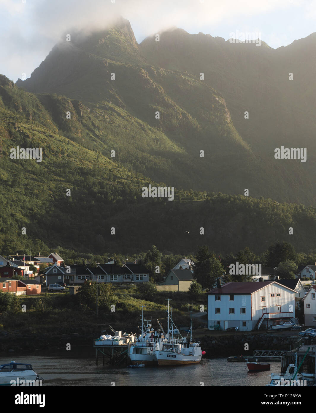 Beautiful landscape of picturesque harbor with fishing boat and traditional Norwegian rorbus in Stamsund, Lofoten islands, Norway Stock Photo