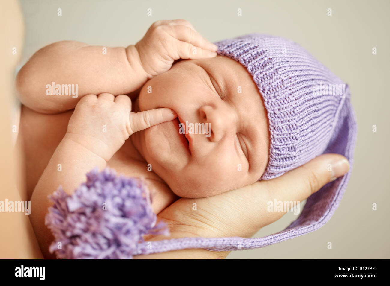 Little Newborn Baby In The Hands Of Parents Mother Father Stock