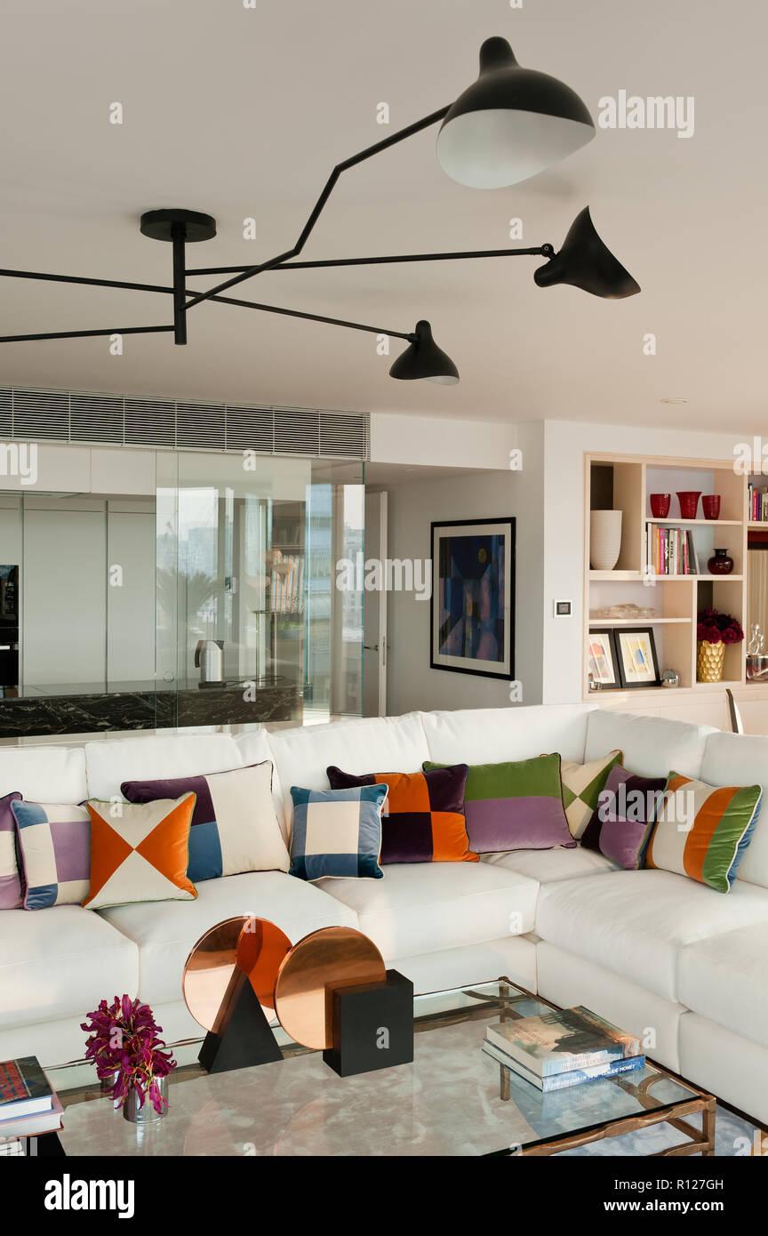 Patterned cushions on sofa - Stock Image