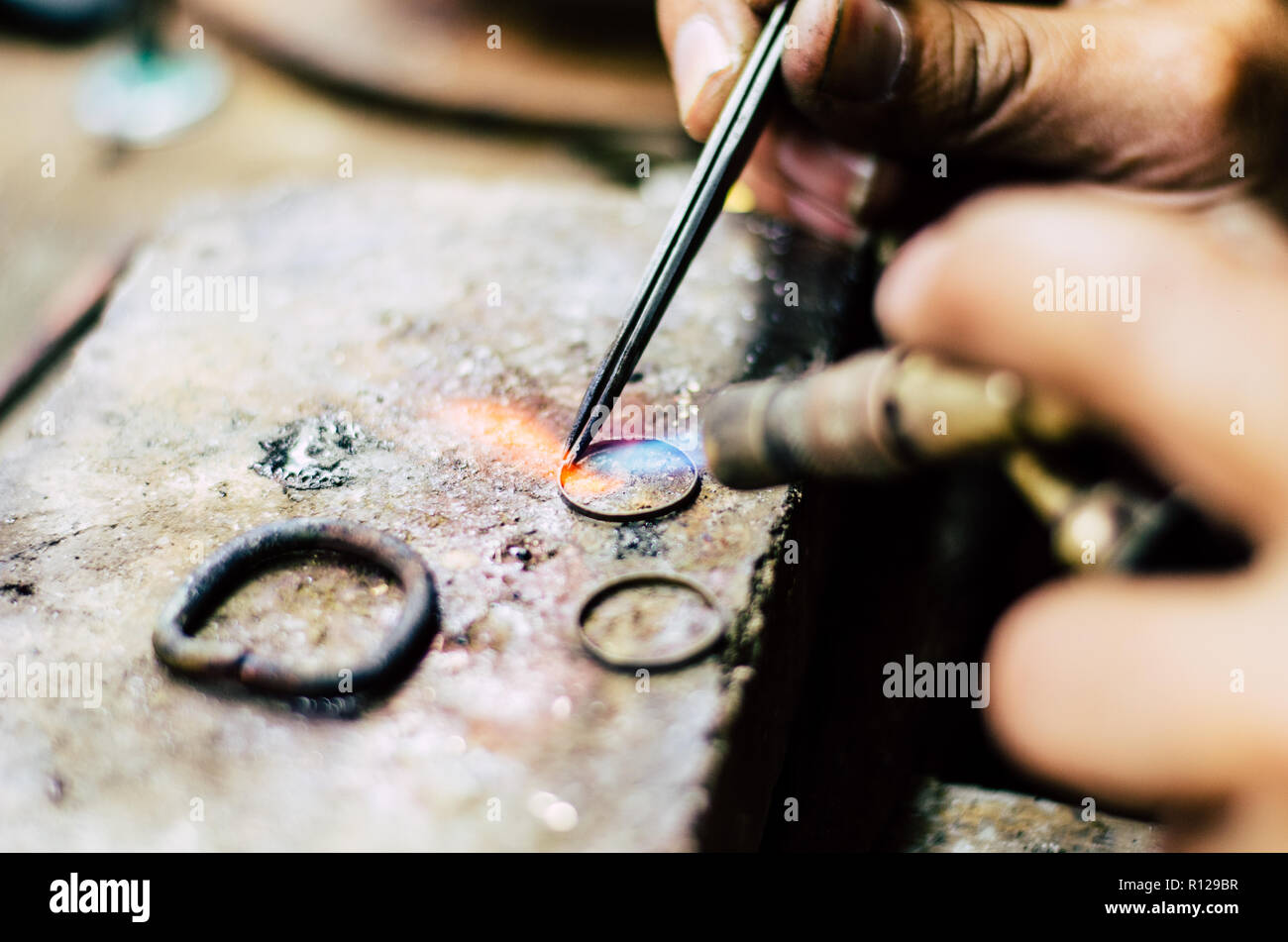 Industrial manufacture of the gold ring. Manufacture of a gold product in the jewelery workshop. - Stock Image