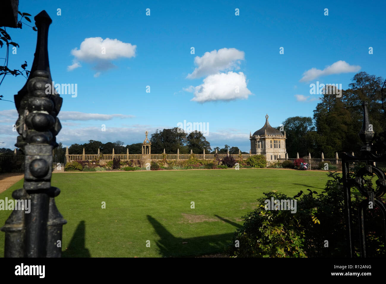 Montacute House Montacute South Somerset. The gardens showing one of two Angle Houses and the quadrangle walls to the west and south - Stock Image