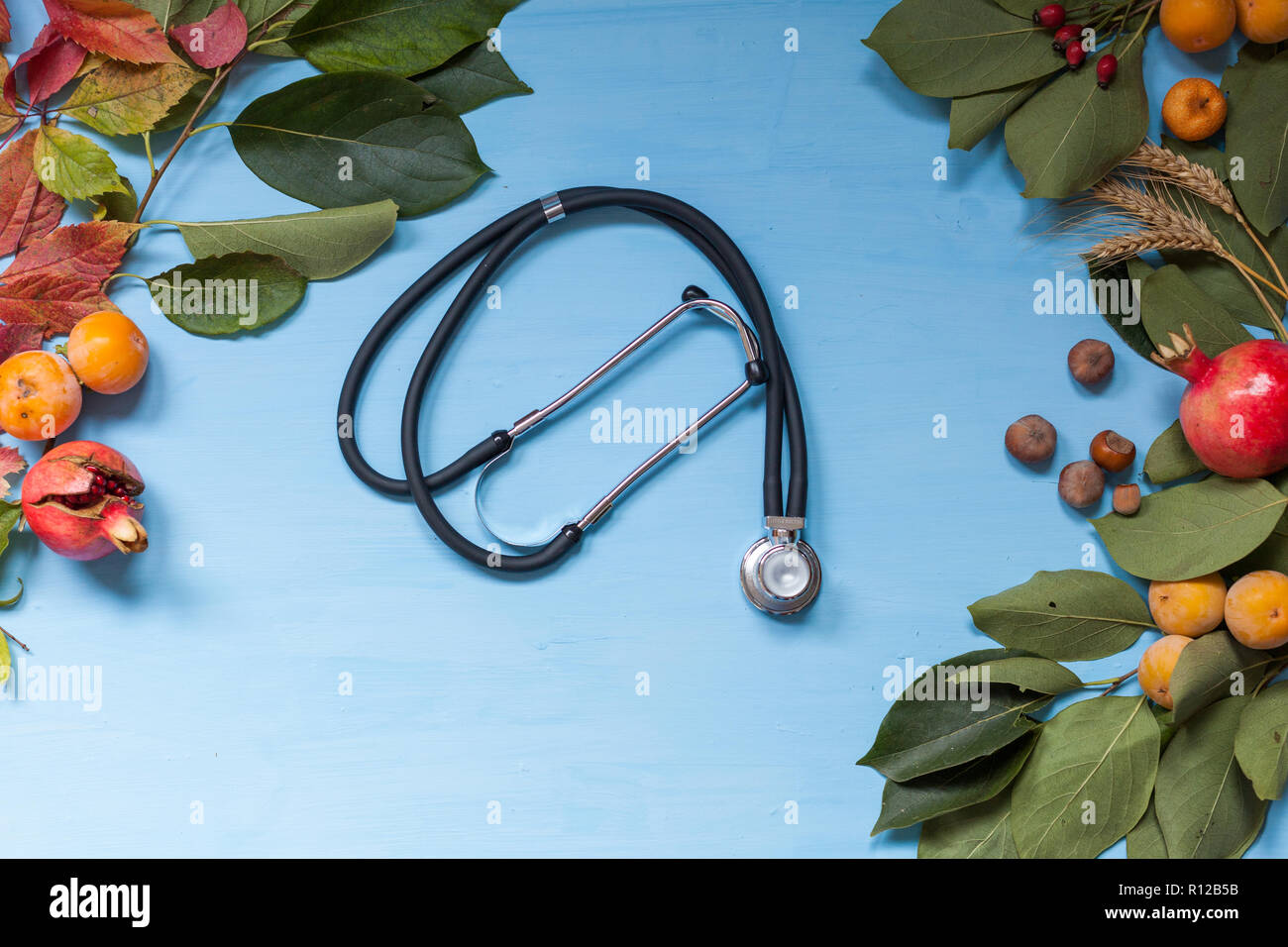 medicine autumn disease doctor stethoscope nice leaves - Stock Image