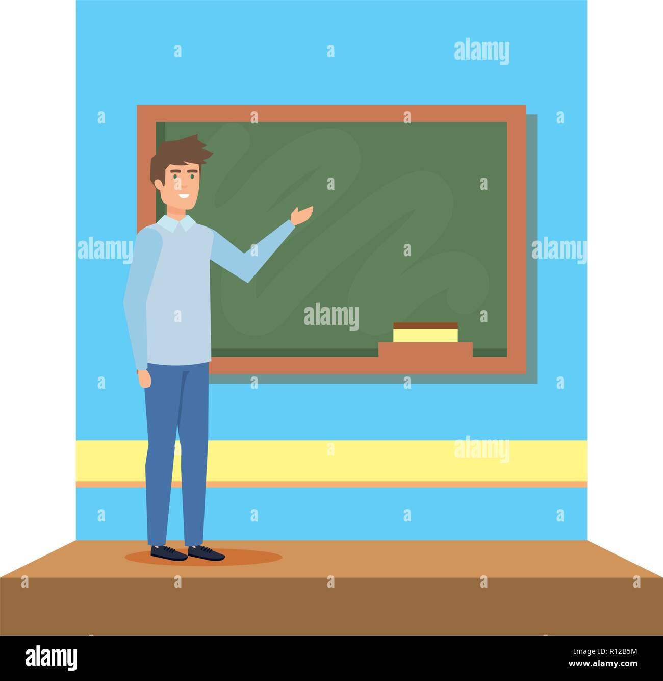 male teacher in the classroom - Stock Image
