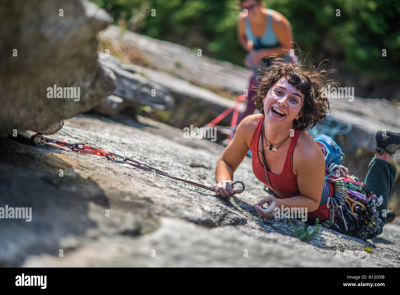 Girlfriends rock climbing, Malamute, Squamish, Canada - Stock Image
