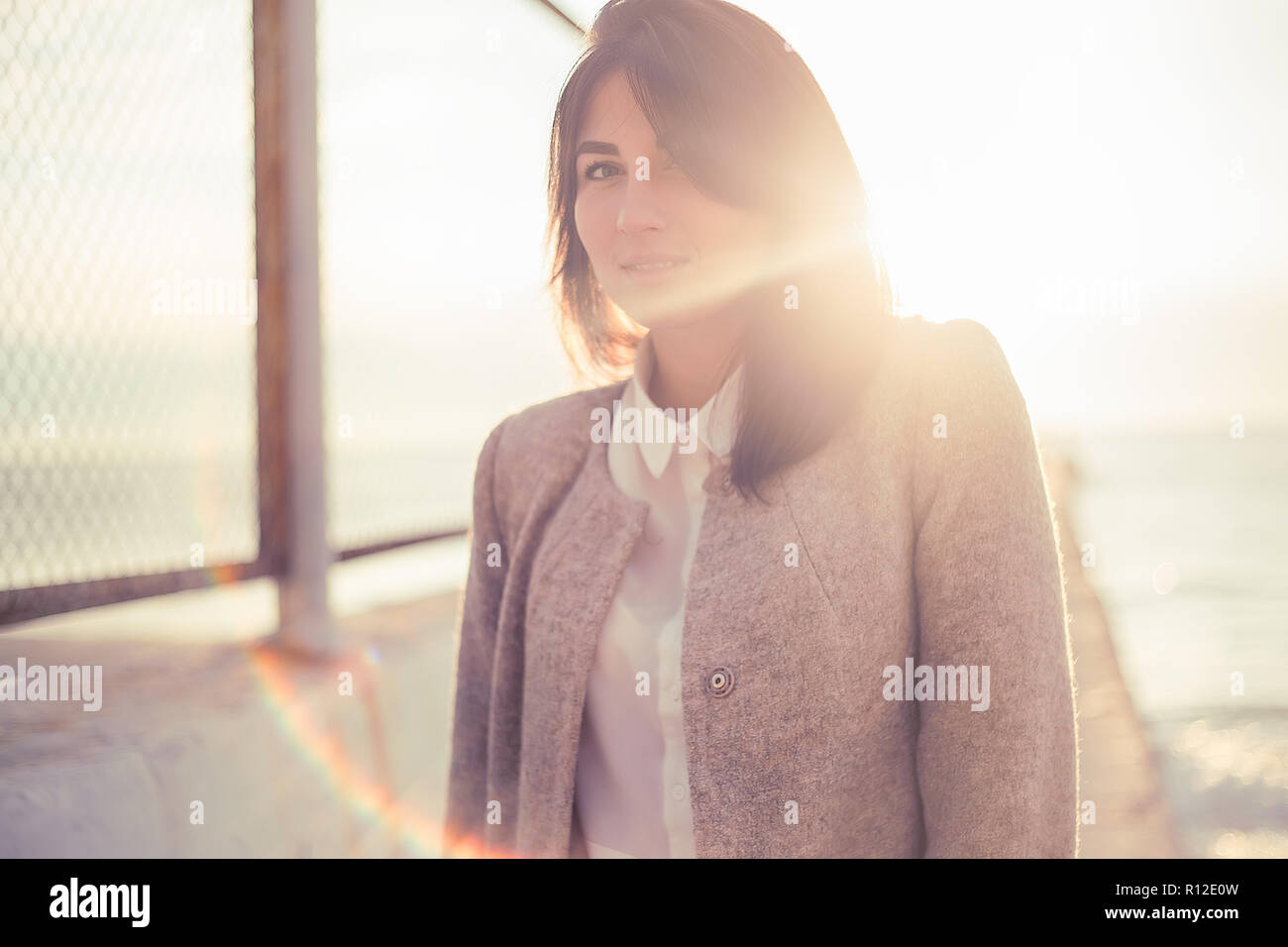Woman near wire fence - Stock Image