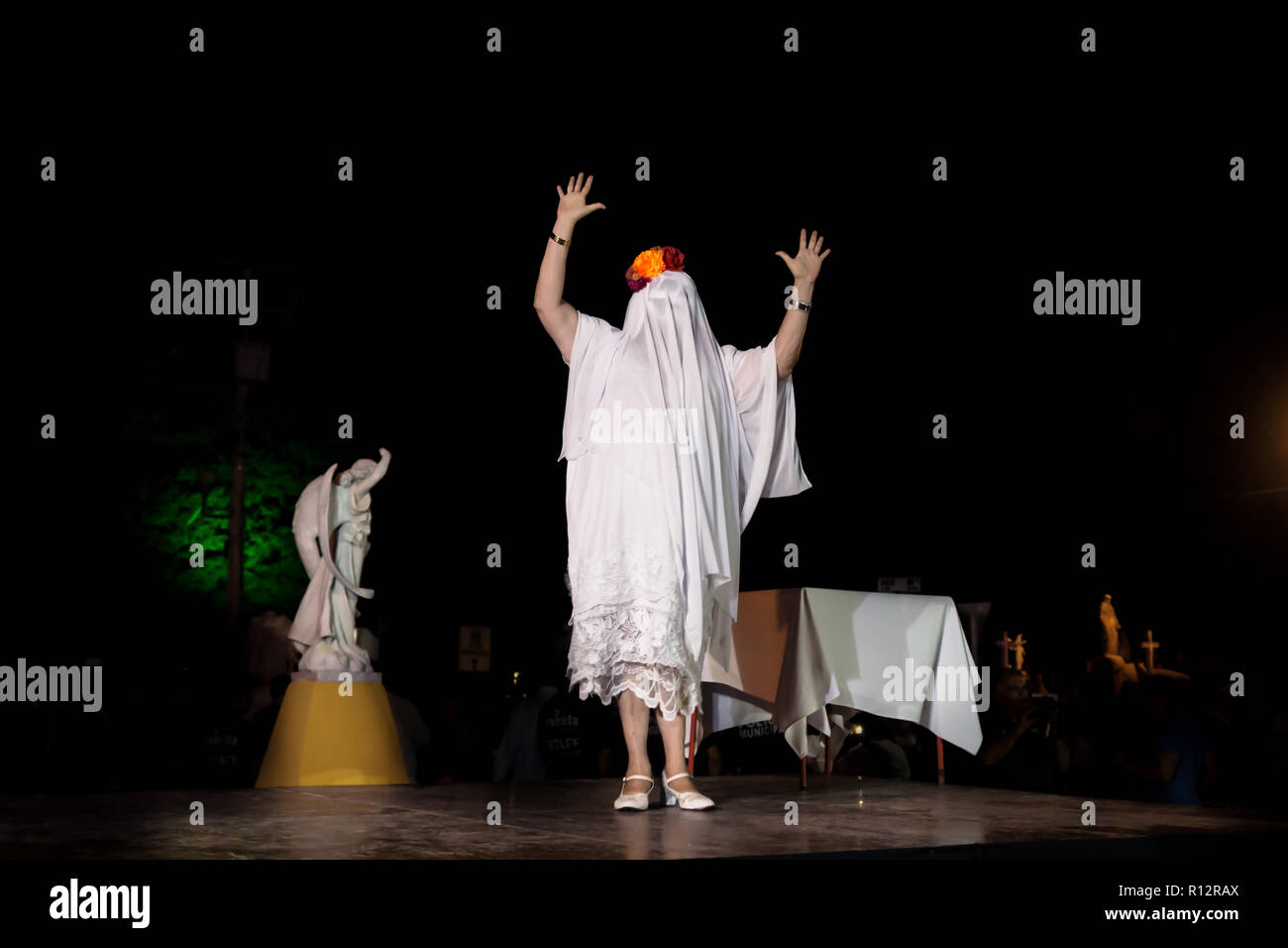 Merida, Cementerio General, Mexico - 31 October 2018: Woman with ghost costume and skull make-up introducing the procession and parade for dia de los  - Stock Image