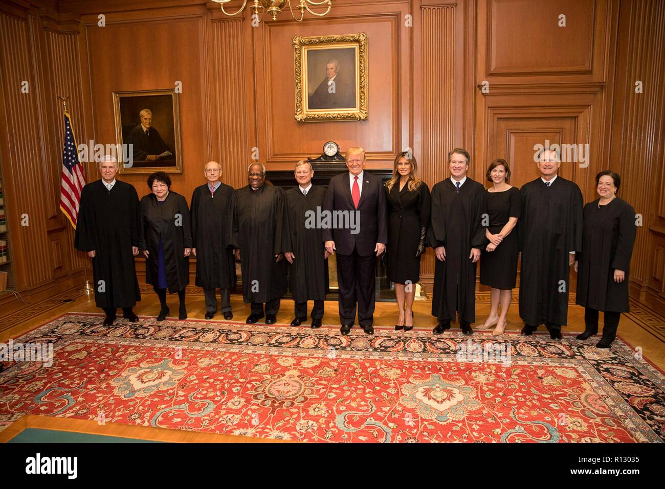 Washington DC, USA. 8th Nov 2018. U.S President Donald Trump and First Lady Melania Trump stands for a photo with Supreme Court Justices in the Justices Conference Room before the investiture ceremony November 8, 2018 in Washington, DC. From left are:  Associate Justices Neil Gorsuch, Sonia Sotomayor, Stephen Breyer, Clarence Thomas, Chief Justice John Roberts, President Donald Trump, first lady Melania Trump, Associate Justice Brett Kavanaugh, Ashley Kavanaugh, and Associate Justices Samuel Alito, and Elena Kagan. Credit: Planetpix/Alamy Live News - Stock Image