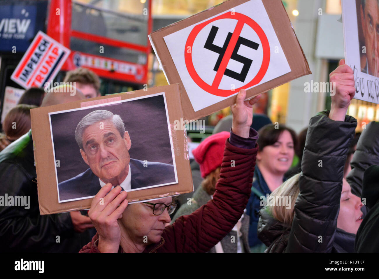 New York, USA. 8th November, 2018. Protesters gathered in Times Square over President Trump's firing of Attorney General Jeff Sessions and to support special counsel Robert Mueller. Credit: Christopher Penler/Alamy Live News - Stock Image